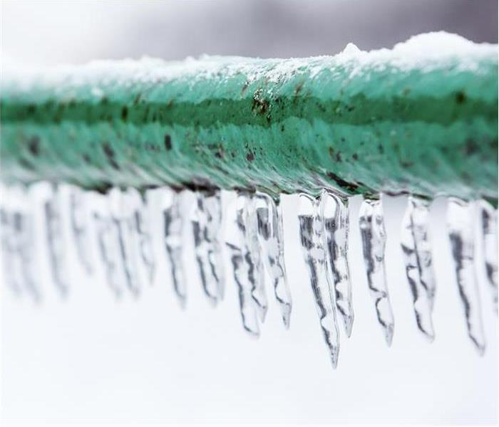 A frozen pipe with icicles hanging down