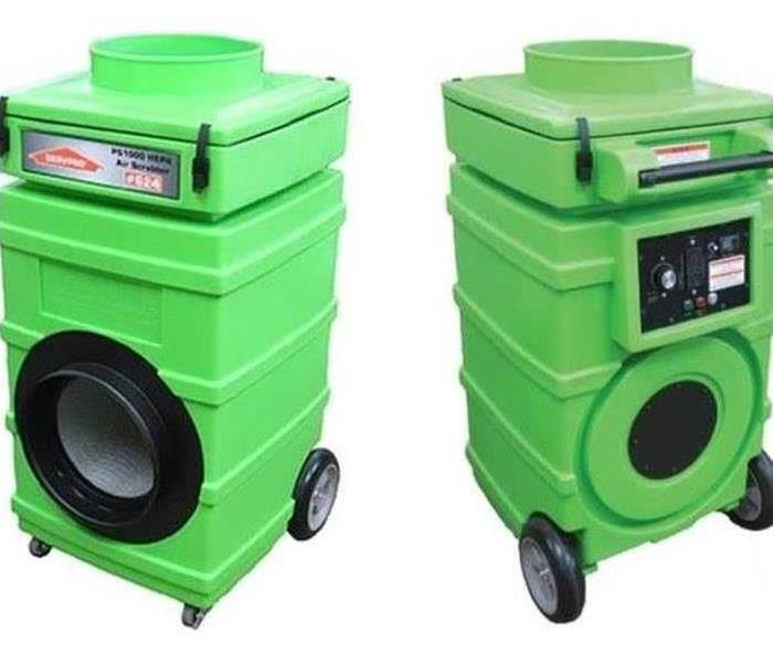 Two green air scrubbers that are used to remove odors.